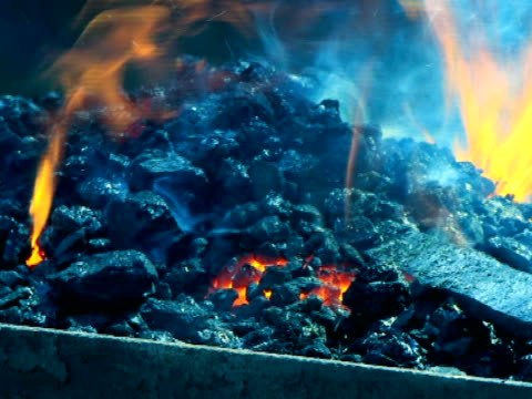 burning coal in blacksmith shop - {{searchview.contributor.websiteurl}} stock videos & royalty-free footage