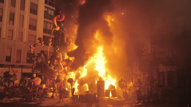 Burning falla in the street. La Crema on the final night of Fallas in Valencia