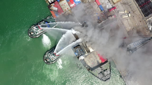 A burning fire boat Products Fire fighter during cargo fire accident at the port