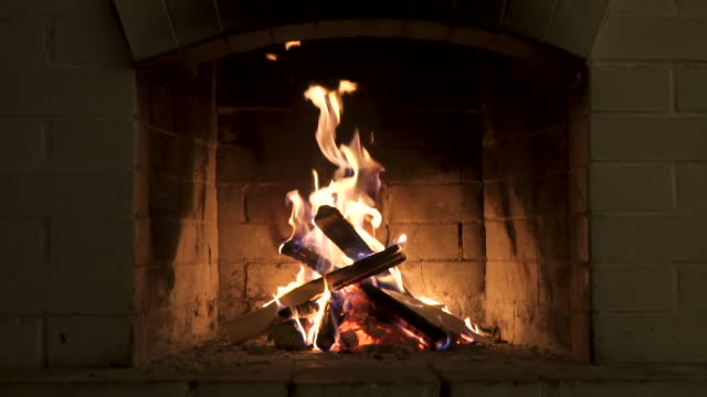 Burning Fire In The Fireplace. Wood And Embers In The Fireplace Detailed fire background. A looping clip of a fireplace with medium size flames fireplace stock videos & royalty-free footage