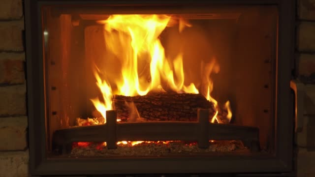 Burning Fireplace - a glowing fire in the stone fireplace to warm at night Burning Fireplace - a glowing fire in the stone fireplace to warm at night fireplace stock videos & royalty-free footage