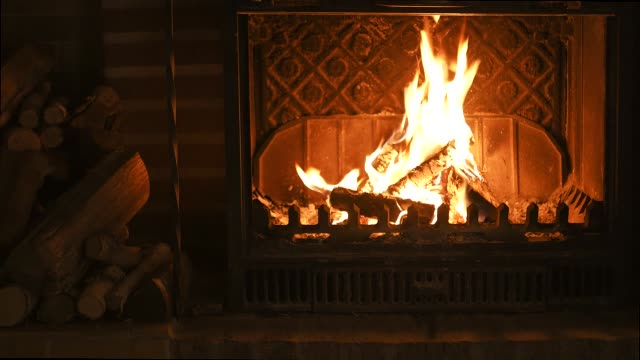 Burning fireplace with firewood. Video footage fire in fireplace - ideal for any holiday decoration. Burning fireplace with firewood. Video footage fire in fireplace - ideal for any holiday decoration. fireplace stock videos & royalty-free footage
