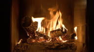 istock Burning fireplace with wooden logs and flame inside. Warm light, romantic atmosphere indoor 1217482832