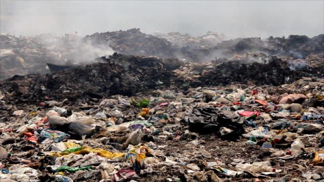 Burning garbage dump, pollution video