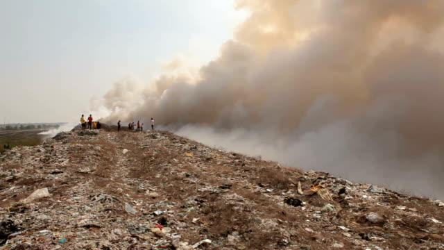 Burning garbage heap of smoke from a burning pile of garbage video