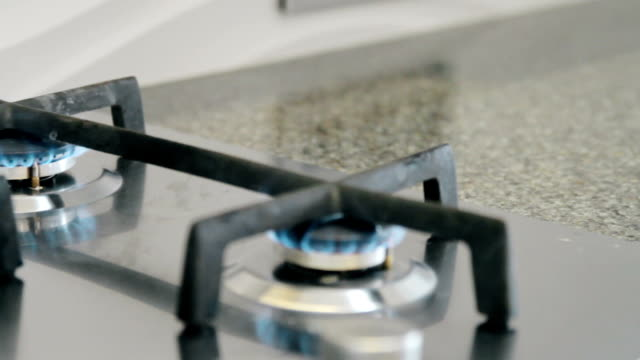Burning gas burners on the stove in the kitchen video