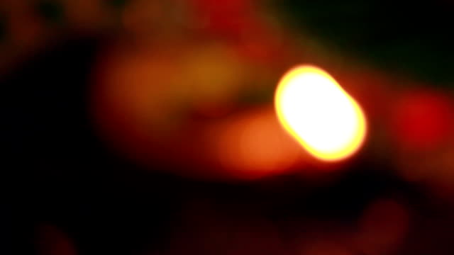 Burning oil lamp defocused video