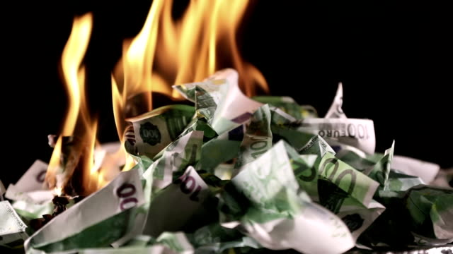 Burning one hundred Euro banknotes Bunch of burning one hundred Euro banknotes rotate on a black background close-up 60fps treasury stock videos & royalty-free footage