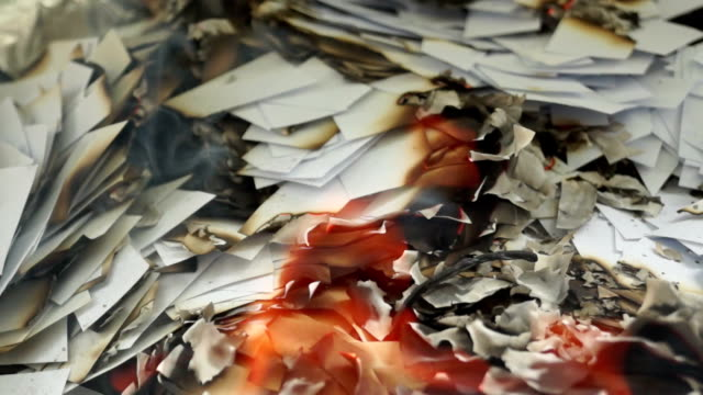 Burning Pieces of Paper 5 Burning small pieces of paper. seared stock videos & royalty-free footage