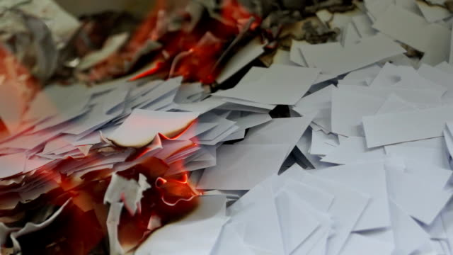 Burning Pieces of Paper Burning slowly small pieces of paper. seared stock videos & royalty-free footage