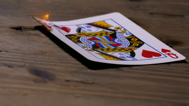 Burning  queen of hearts poker card video
