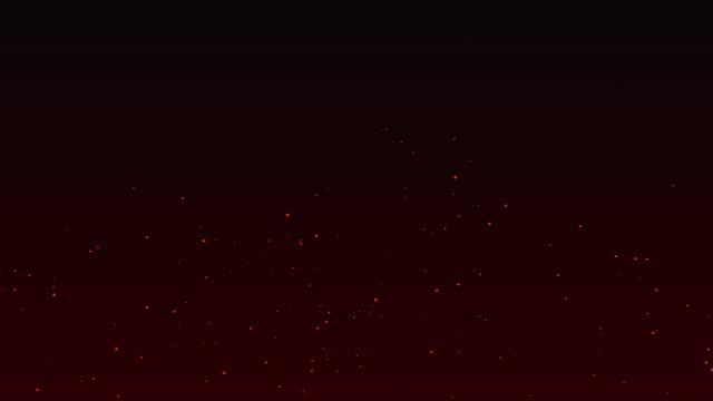 scintille rosse che sceno di fuoco su sfondo nero. astratto fuoco incandescente particelle 4k animazione. - tizzone video stock e b–roll