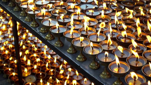Burning ritual candles in nepali temple. Kathmandu, Nepal. video