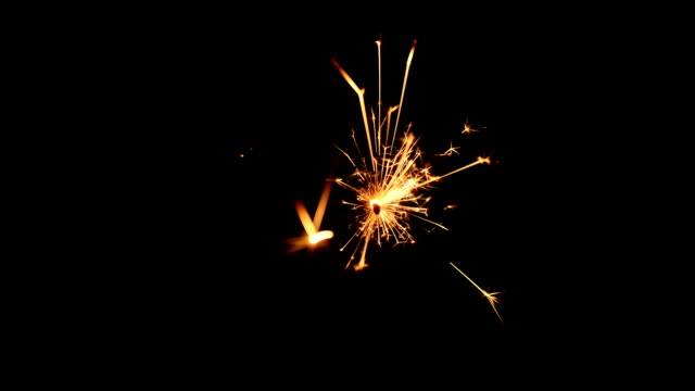 burning sparkle lights burning sparkle lights isolated on black background pyrotechnic effects stock videos & royalty-free footage