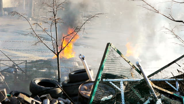 Burning tyres near barricade - Protests 2014 video