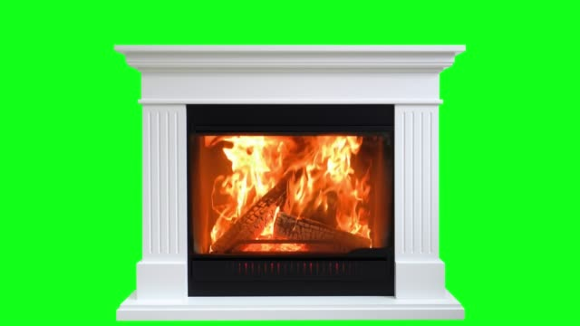 burning wood in fireplace isolated on green screen. perfect for your own background using green screen - camino video stock e b–roll