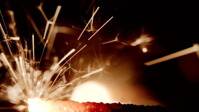Burnout syndrome, stress, exhaustion and Mission Impossible Christmas New Year Fire Cracker and Sparkler burns out in red heat flame over Bokeh black background, Super Close up 4k. concept of Burnout syndrome, stress, exhaustion and Mission Impossible firework explosive material stock videos & royalty-free footage