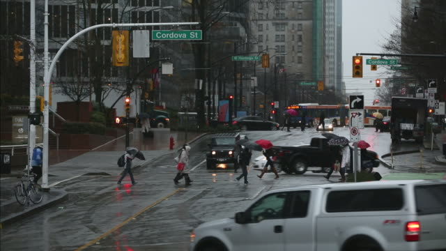 Burrard Street Rain, Vancouver Busy downtown Burrard Street street during a rain storm. Vancouver, British Columbia, Canada. vancouver canada stock videos & royalty-free footage