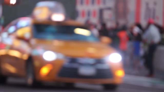 Burred NYC street scene in times square with rush hour traffic. video
