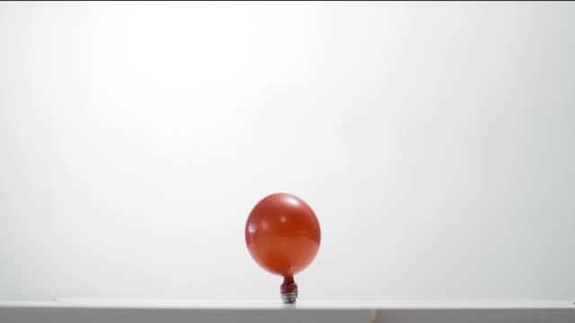 Bursting red balloon video