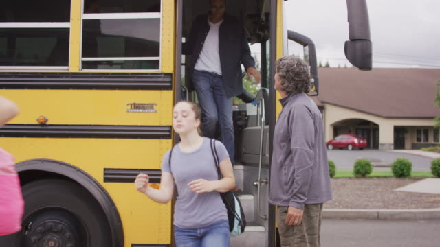 Bus driver ushering students off of school bus video