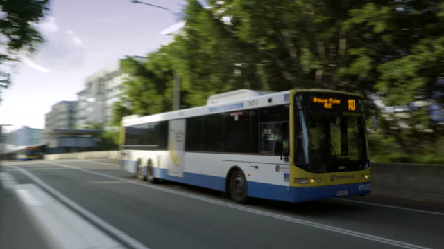 A bus enters a tunnel A modern bus, powered by diesel, drives along a busway and enters an underground tunnel. bus stock videos & royalty-free footage
