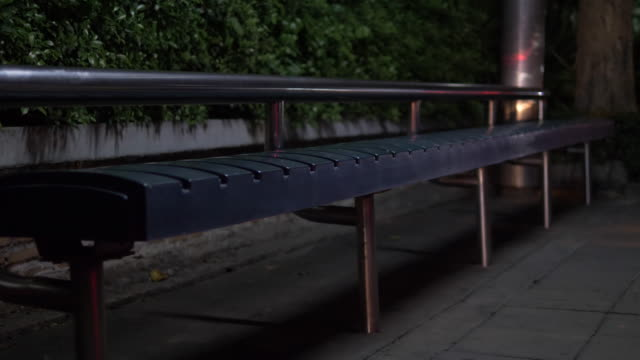 Bus stops are empty, there are no people on the streets of the city at night. Bus stops are empty, there are no people on the streets of the city at night during the epidemic. bus stop stock videos & royalty-free footage