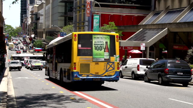 Bus, taxi and cars traffic downtown brisbane video