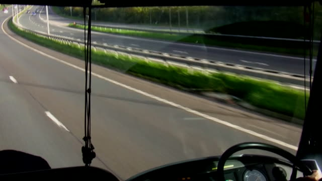 bus windscreen view driving motorway in uk - bus driver stock videos and b-roll footage