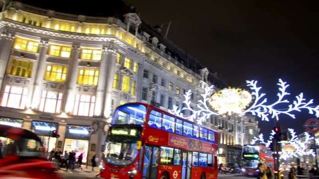 Buses and cars drive through Regent Street under the Christmas lights video