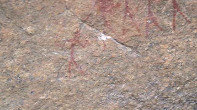 Bushman paintings in Namibian desert, Africa, panning shot video