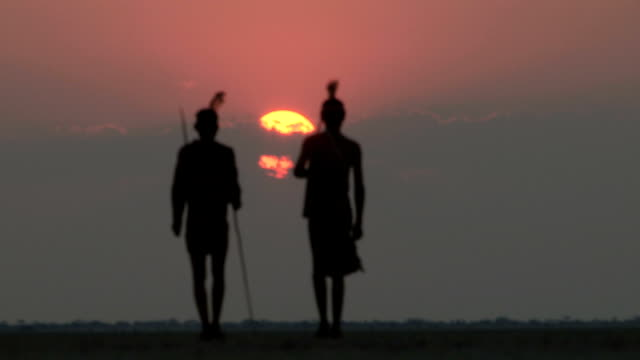 [Image: bushmen-walking-into-the-sunset-on-the-m...?s=640x640]