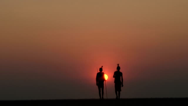 Bushmen walking into the sunset on the Makgadikgadi Pans Bushmen walking into the sunset on the Makgadikgadi Pans makgadikgadi pans national park stock videos & royalty-free footage