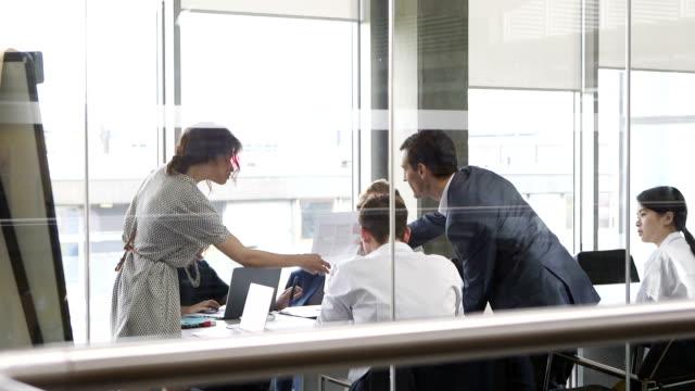 Business Associates Analysing Data