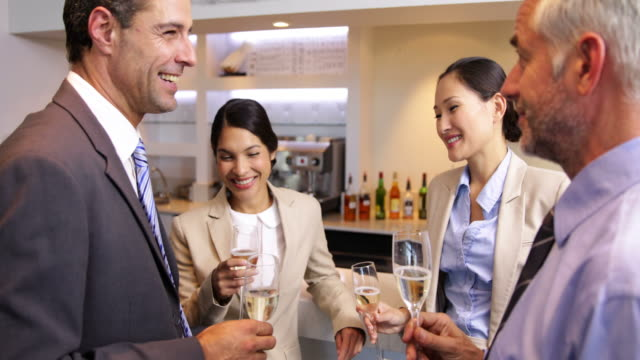 Business associates celebrating after work and drinking wine video