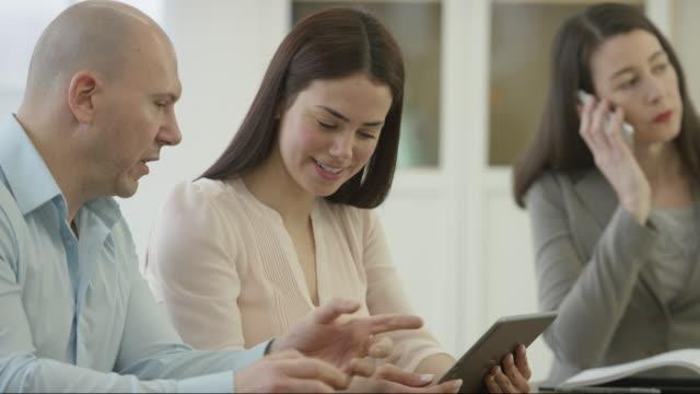 Business Associates Discussing Online Marketing Strategies video