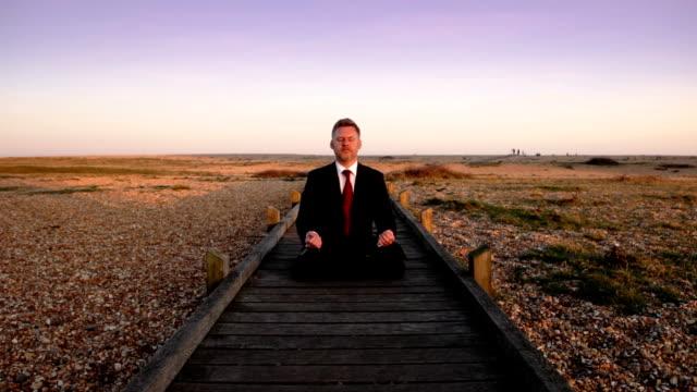 Business beach meditation video