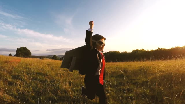 Business Boy runs through English Field with jet pack video