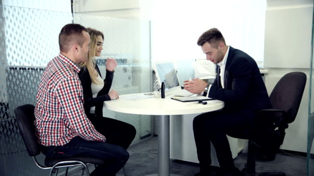 Business broker having a meeting with clients video