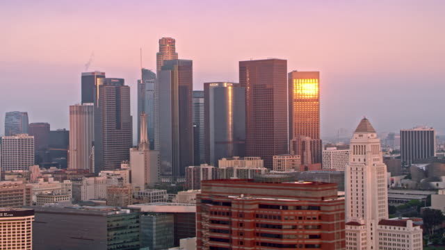 AERIAL Business buildings in Downtown LA shining in the morning sun
