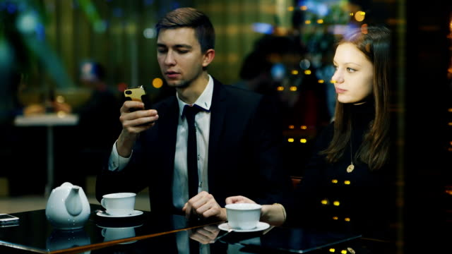 Business call during a romantic date with a woman video