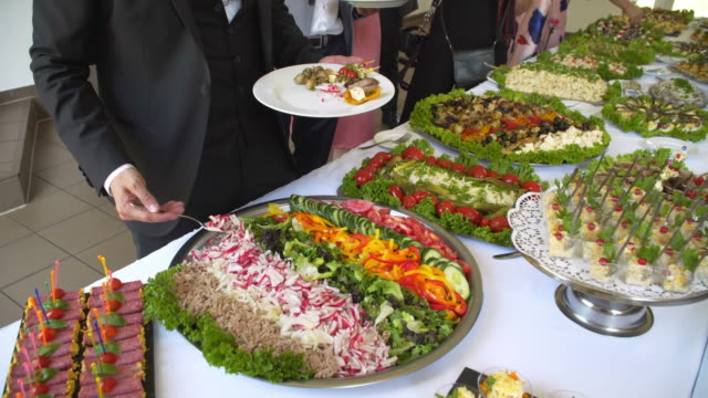 business catering people take buffet food during company event - group of people стоковые видео и кадры b-roll