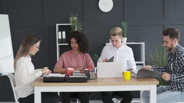 Business colleagues at meeting Business colleagues discussing over financial report at office meeting casual clothing stock videos & royalty-free footage