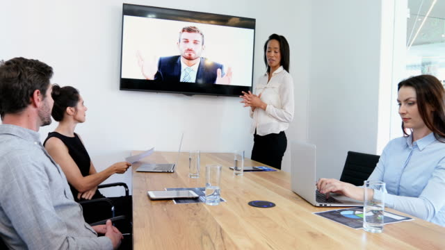 business colleagues attending a video call in conference room 4k - conference call stock videos & royalty-free footage