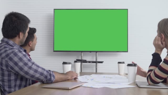 Business Colleagues Attending A Video Call In Conference Room Green Screen Video of business colleagues attending a video call in conference room with green screen. 4K workshop stock videos & royalty-free footage
