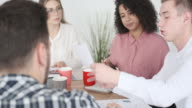 istock Business colleagues discussing with financial report 1153607528