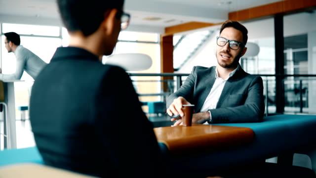 business colleagues having conversation during coffee break - коллега стоковые видео и кадры b-roll