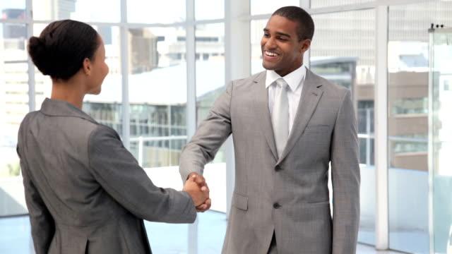 business colleagues shaking hands - formell klädsel bildbanksvideor och videomaterial från bakom kulisserna