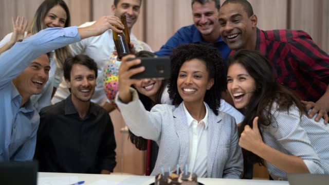 business colleagues taking a selfie at birthday party at work - office party stock videos and b-roll footage