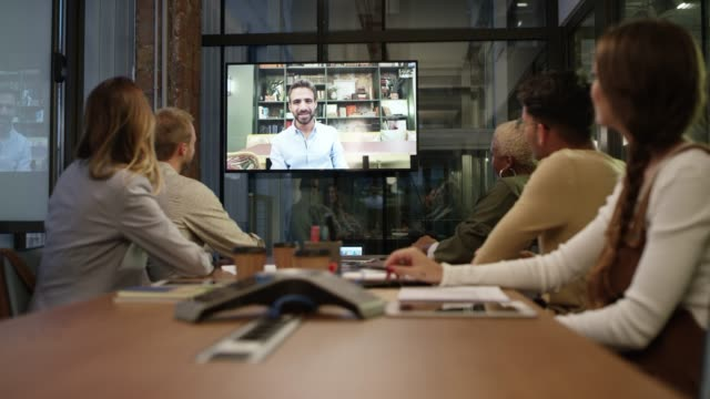 business colleagues video conferencing at office - collega d'ufficio video stock e b–roll